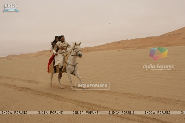 Abhishek and Priyanka running in a horse