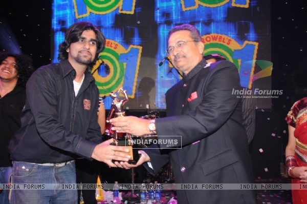 Growel Group Chairman Mr. Umesh More awarding the winner of Growel Idol