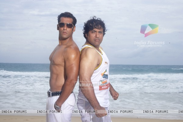 Salman and Govinda showing their body