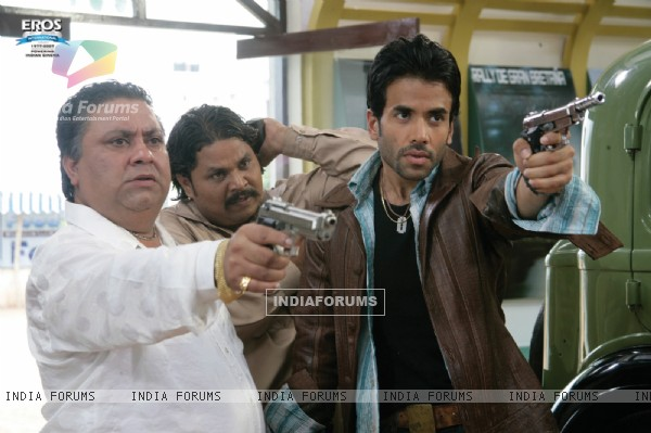 Tusshar and Manoj with a rifle