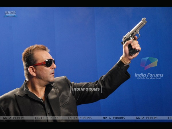 Sanjay Dutt aiming with a gun