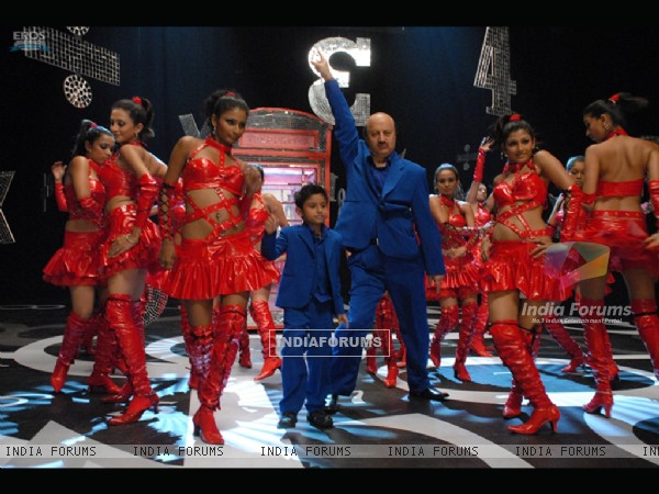 Anupam Kher dancing with a small boy
