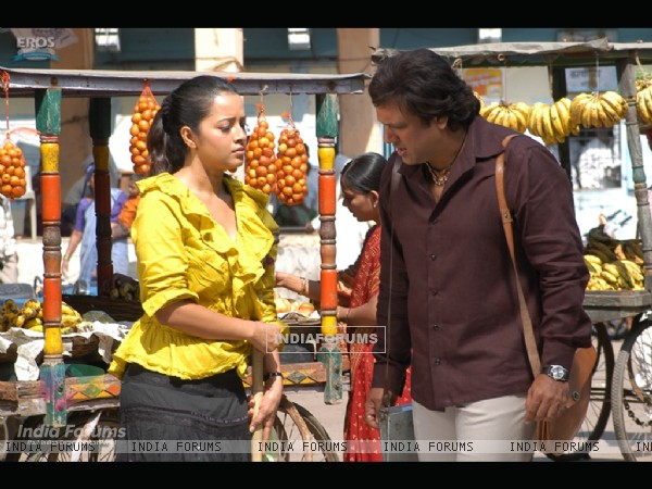 Govinda talking to Reema Sen