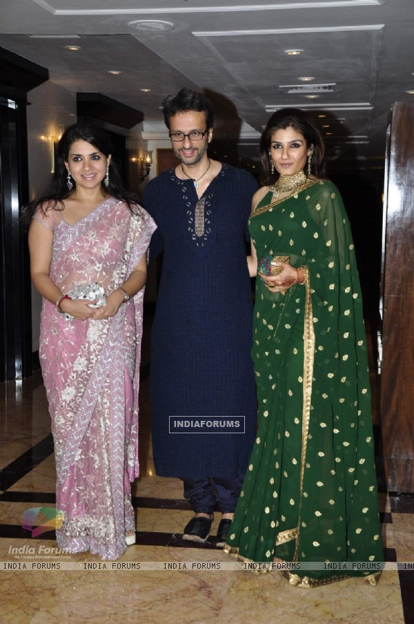 Raveena Tandon with her husband in Sameer Soni and Neelam's wedding reception at Taj Land's End