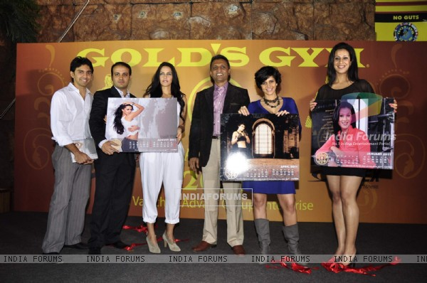Neha Dhupia and Mandira Bedi launches Gold Gym Calendar at Bandra. .