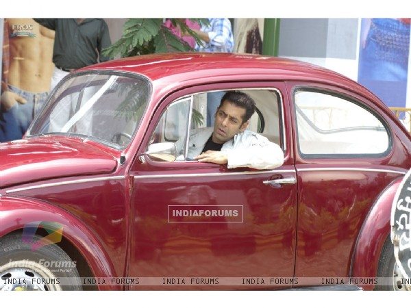 Salman Khan sitting on a car