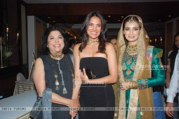 Lara Dutta and Dia Mirza walking on the ramp for Ritu Kumar fashion show at Taj land's End. .