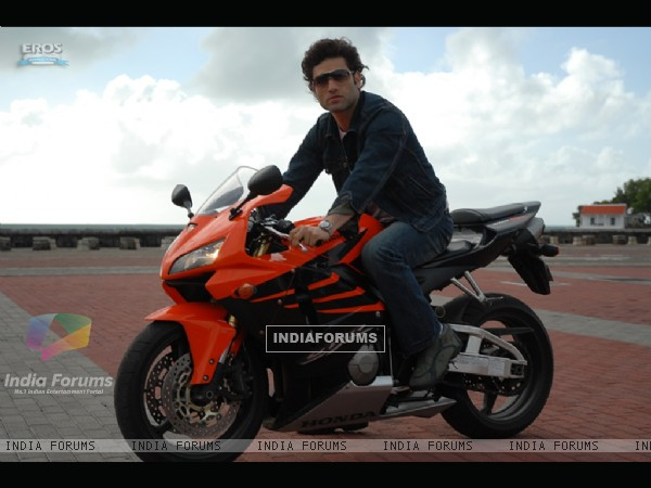 Shiney Ahuja sitting on a bike