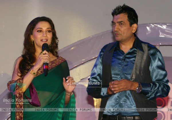Madhuri Dixit and Sanjeev Kapoor at the launch of ''Food Food'' foundation in New Delhi