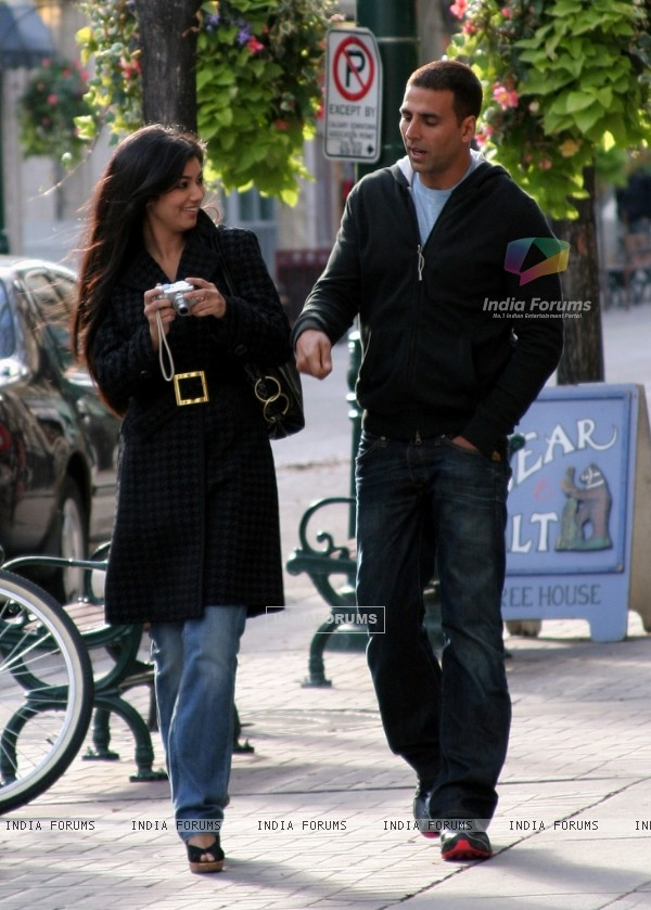 Akshay and Ayesha walking on the footpath