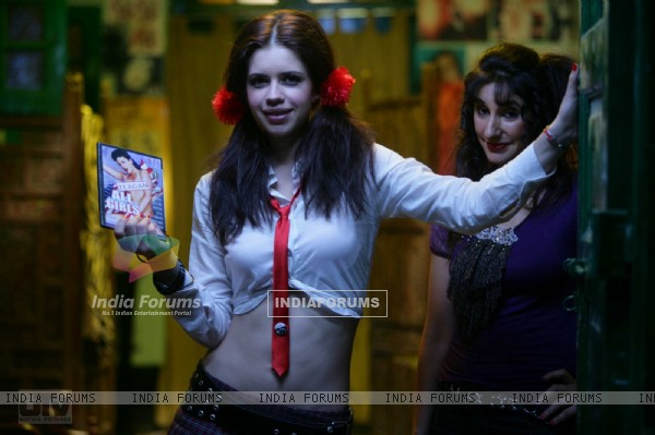 Kalki Koechlin with a CD box