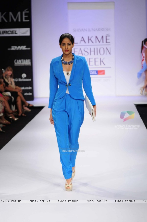 A model showcases a creation by designers Shivan and Narresh at Lakme Fashion Week day 2 in Mumbai. .