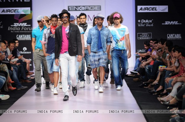 Models walks the runway at the Energie show at Lakme Fashion Week day 2 in Mumbai. .