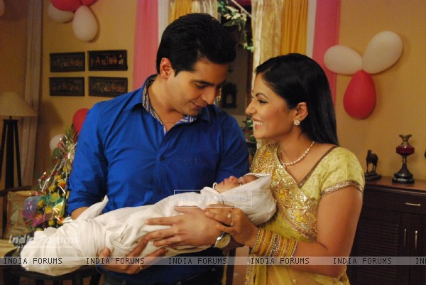 Akshara and Naitik playing with baby