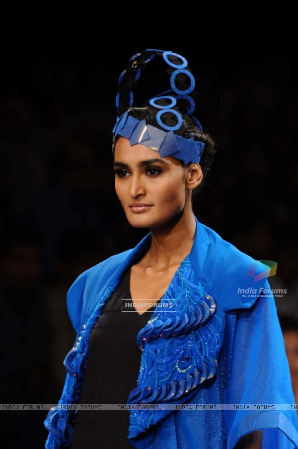 A model displays designer Harangad Singh's creations during the Lakme Fashion Week 2011 Day 5 in Grand Hyatt, Mumbai. .