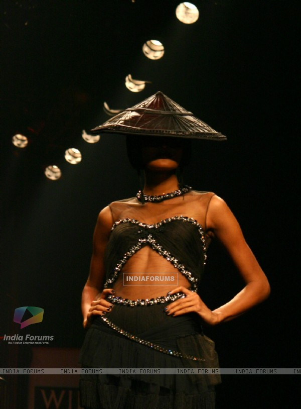A model showcasing designer Tarun Tahiliani's creation at the Wills Lifestyle India Fashion Week autumn winter 2011,in New Delhi on Wednesday. .
