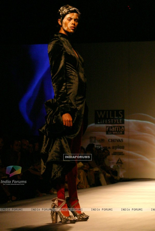 A model showcasing designer Gaurav Gupta's creation at the Wills Lifestyle India Fashion Week autumn winter 2011,in New Delhi on Saturday 9 April 2011. .