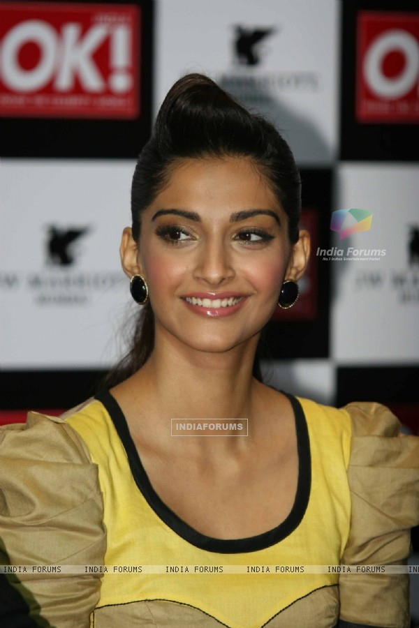 Sonam Kapoor shows off the OK magazine cover at its launch event held at Enigma in Mumbai