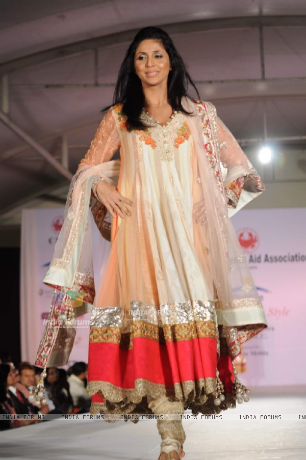 Gautami Kapoor walk the ramp for Shaina NC and Manish Malhotra at the Pidilite-CPAA charity fashion show