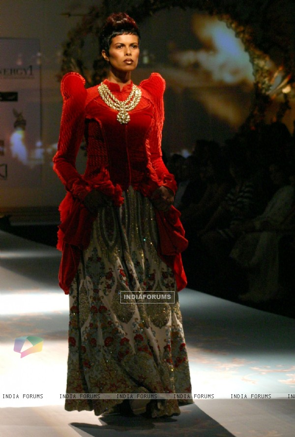 Model walks the ramp for designer Varun Bhal's creation at the Synergy one Delhi Couture Week