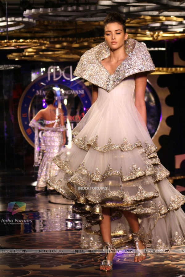 A model showcasing designer Manav Gangwani's creation at the Synergy1 Delhi Couture Week, in New Del