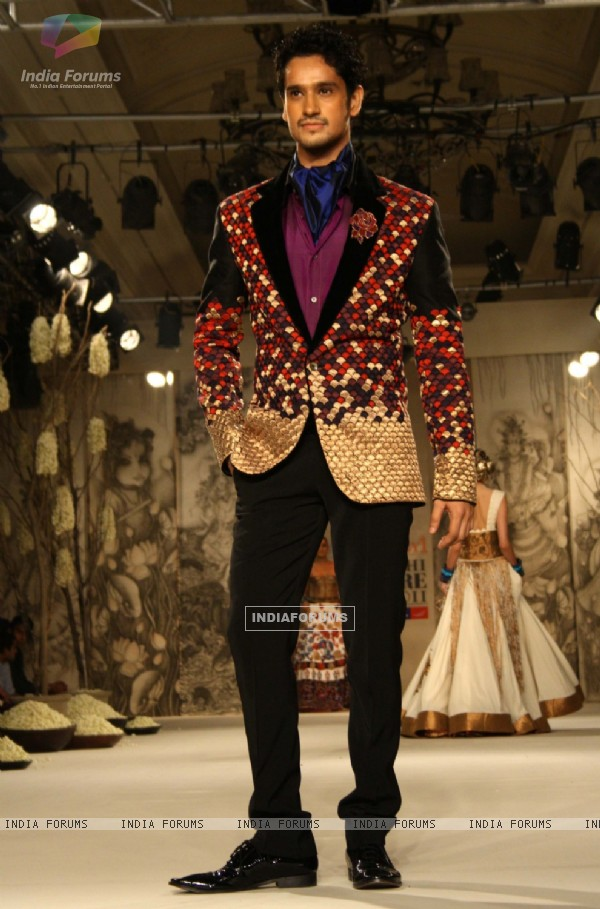 A model showcasing designer Rohit Bal's creation at the Synergy1 Delhi Couture Week,in New Delhi