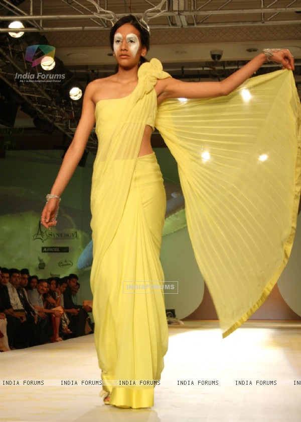 A model showcasing designer Gaurav Gupta's creation at the Synergy1 Delhi Couture Week,in New Delhi
