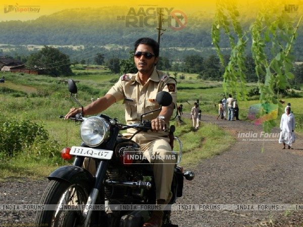 Shreyas Talpade riding a bike