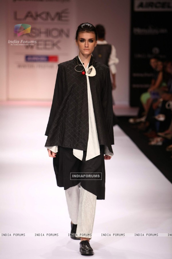 Model displays designer Paromita Banerjee's creation during the Lakme Fashion Week Day 3 in Mumbai. .
