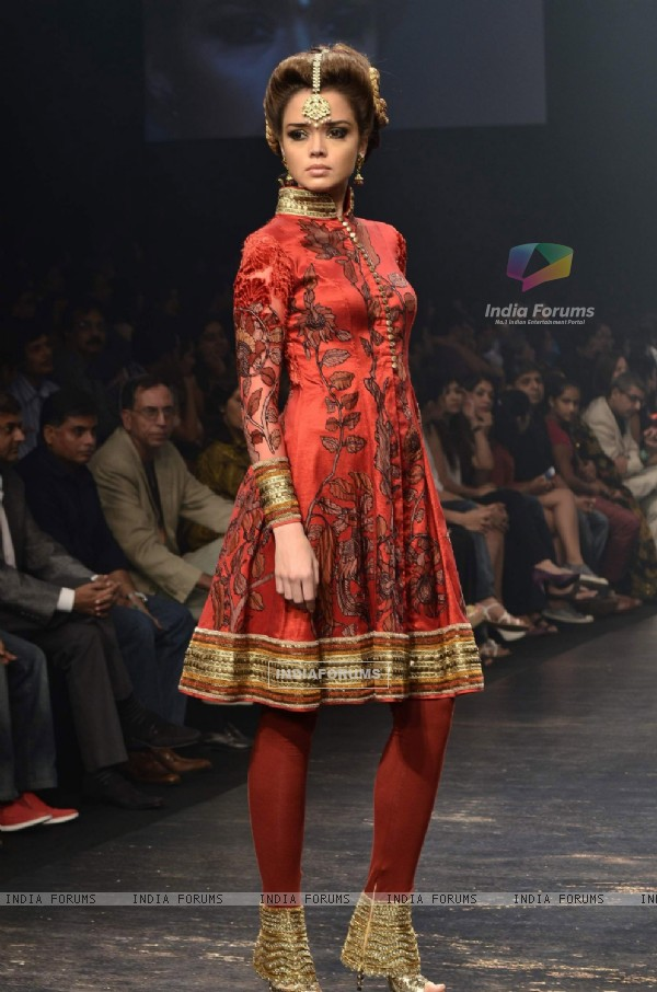 Model displays designer Neeta Lulla's creation during the Lakme Fashion Week Day 4 in Mumbai. .