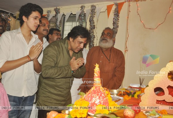 Govinda paying devote to Lord Ganesha during the occasion of Ganesh Chaturthi at their home