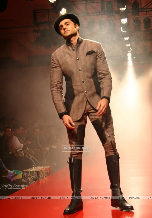 A model showcasing designer Arjun Khanna's creation at the Ven Heusen India Mens Week 2011, in New Delhi on Friday. .