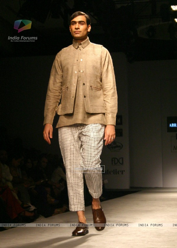 A model showcasing designers Abraham & Thakore's creation at the Van Heusen India Mens Week 2011, in New Delhi on Saturday. .