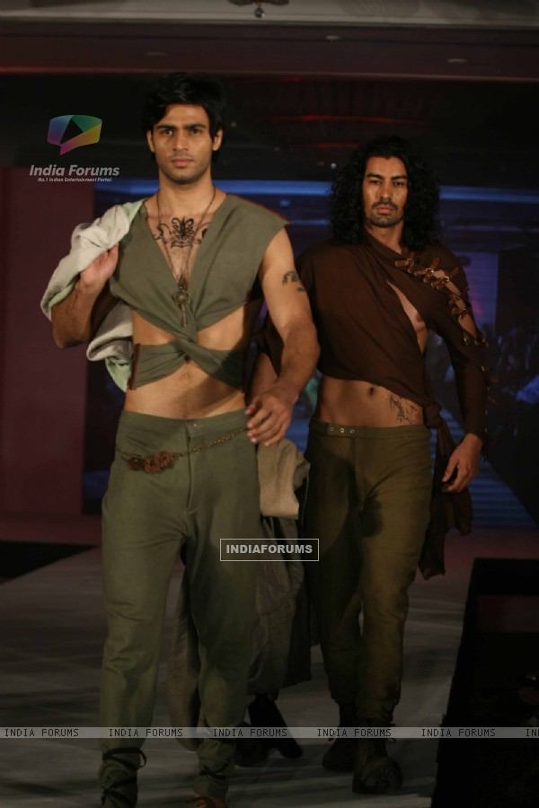 Model walks the ramp for WLC Chimera fashion show at Leela Hotel