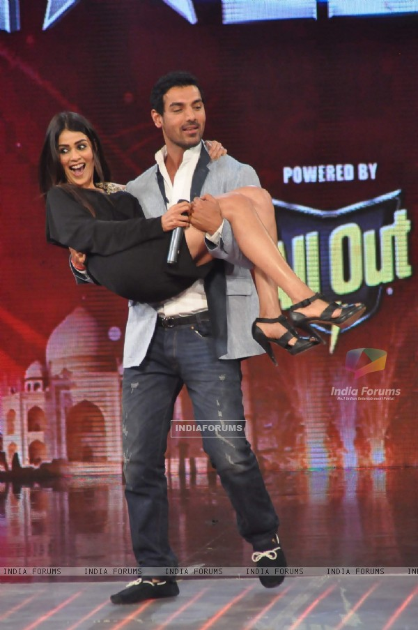 John Abraham and Genelia D'souza on the sets of India's Got Talent at Film City. .