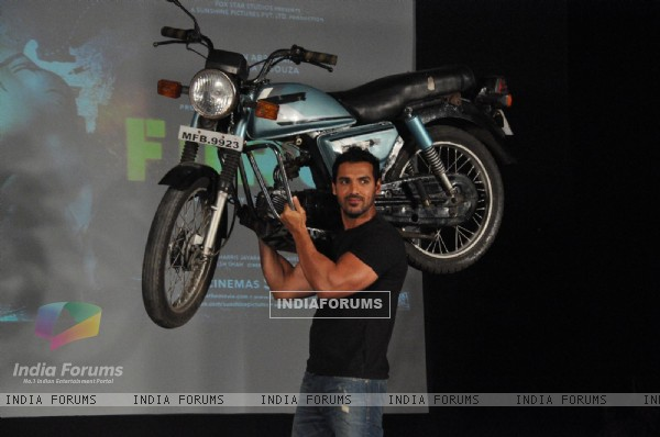 John Abraham holds up bike during the promotion of their film 'Force' in Mumbai