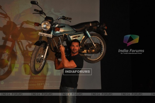 John Abraham holds up bike during the promotion of their film 'Force' in Mumbai (161276)