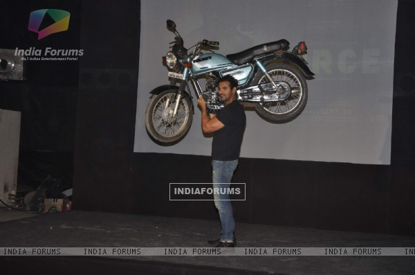 John Abraham lifts a bike at Force promotions in Mehboob, Mumbai (161343)