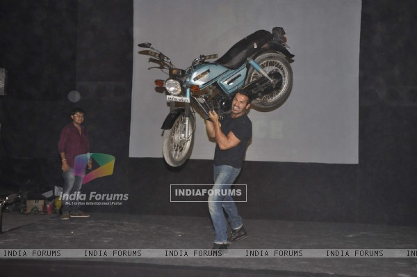John Abraham lifts a bike at Force promotions in Mehboob, Mumbai