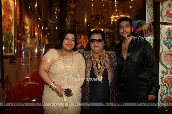 Bappi Lahiri with wife and son at Sarbojanin Durga Puja Pandal in Mumbai