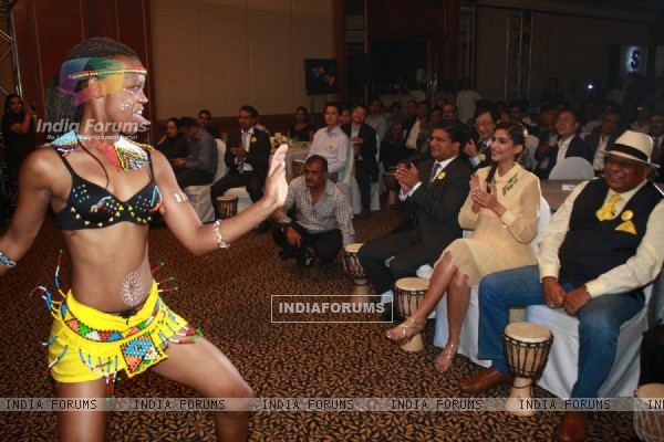 Sonam Kapoor enjoying the African dance performances at new range launch of Spice Mobiles in Mumbai