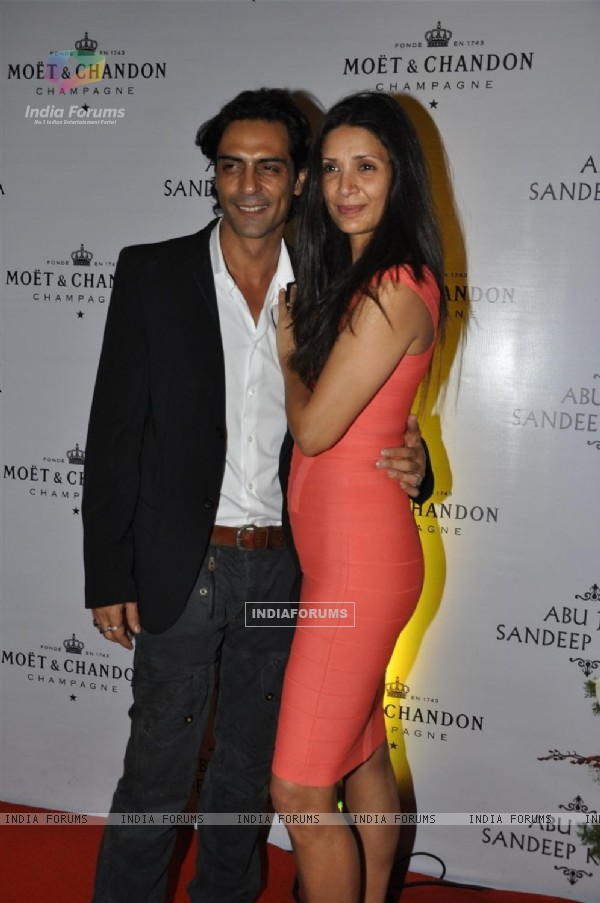 Arjun Rampal with wife grace Abu Jani and Sandeep Khosla's 25th year bash at the Grand Hyatt, Mumbai