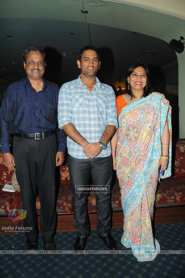 Mahendra Singh Dhoni with Y.P. singh and Abha Singh releasing the music of the film and Novel