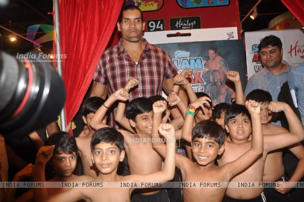 "WWE Superstar Khali poses during the launch of game ""The Great Khali"" at Hamleys"