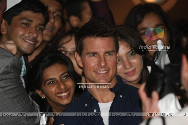 Tom Cruise poses for a photo before a special screening of film Mission Impossible at IMAX Wadala