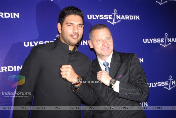 Indian cricketer Yuvraj Singh poses during the unveiling of 'Ulysse Nardin' limited edition watches in Mumbai