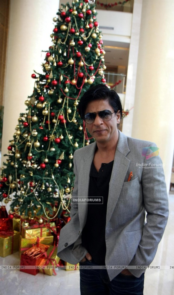 Shah Rukh Khan posing with a Christmas Tree in a Christmas Special photo shoot at Hotel Trident