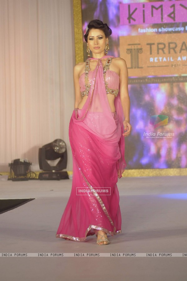 Model walk the ramp for Kimaya fashion show at Trrain Retail Awards in Taj Lands End. .