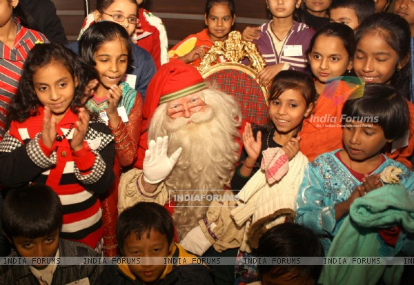 Celebrating the spirit of Christmas the official Santa Claus from Lapland ,Finland with underprivileged children at Le Meridien ,in New Delhi. .