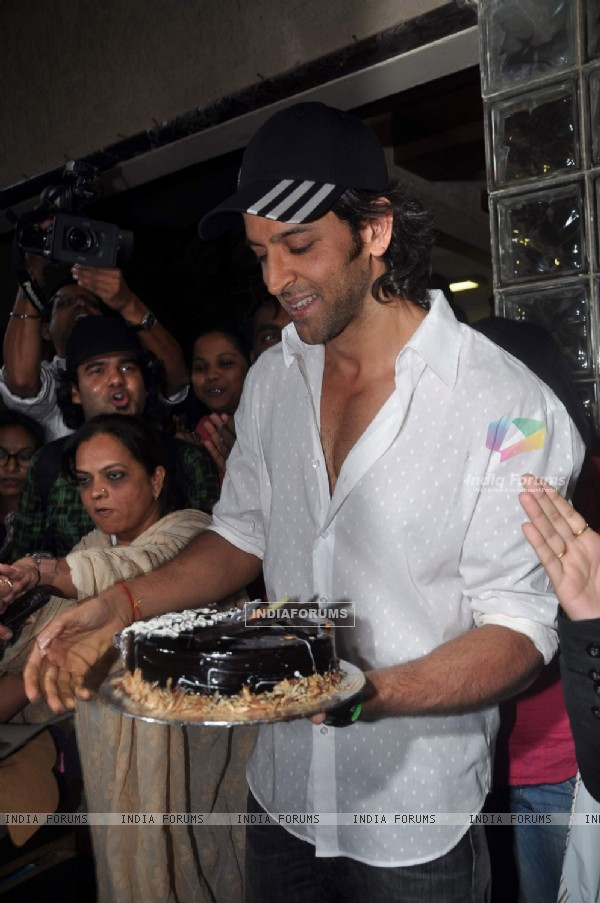 Hrithik Roshan poses with his birthday cake as he celebrates his 38th Birthday in Mumbai